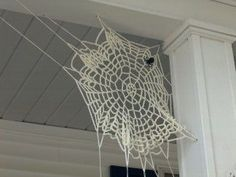 Crocheted Spider Web -- Classy Halloween Decor for sure! Maybe I will attach mine to an L-bracket for easy installation each year.