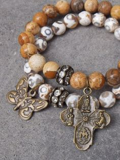 Antique bronze 4 way cross with Images of Miraculous Medal, Scapular Medal, St. Joseph and St. Christopher and a Tibetan Agate Gemstone beaded bracelet with a butterfly charm both bracelets have Pave