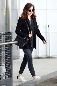 Stylish landing: Lily Collins looked every inch the chic New York girl as she jetted into the Big Apple on Monday
