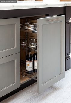 beautiful kitchen cabinets  like the idea of a pull-out for spices and oils, etc.