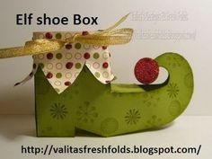 So cute! How to make an elf-shoe gift box. Download pattern/template at http://media-cache-ec0.pinimg.com/originals/0d/aa/be/0daabe9a121843e52fe84cf8c852bb4c.jpg, then watch video for cutting and assembly instructions.