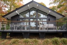 This private residence off a beautiful, secluded road in The Hamptons features a modern façade clad in reSAWN's HAI shou sugi ban charred wood specified by BAHND design studio.