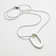 silver and brass pebble necklace pendant on short by papermetal, $115.00