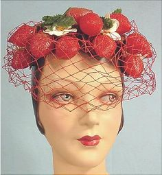 Claudia was ready to take on the world in her strawberry hat. 1940s