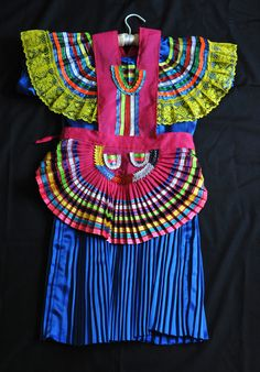 "Maya Dress and Apron Mexico | by Teyacapan. This traje is from Patihuitz, a tseltal Maya village in the selva lacandona region of Chiapas, Mexico. The costume consists of a one-piece dress and a small apron called a ""gabacha"""