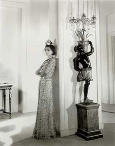 A feminine side of Coco Chanel in an Art Deco portrait by Cecil Beaton. Sweet rose headpiece.