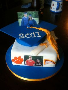 Personal graduation cake then surrounded by cupcakes for guests