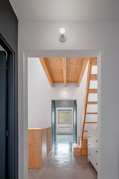 Opposite the main stair on the first floor, a set of ladder-style steps lead up to a small extension tucked under the exposed wood of the roof. Patio Interior, Stairs, House, Home Decor, Staircases, Timber Frames, Houses, Architects, Facades