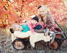 three cute sisters in a vintage wagon