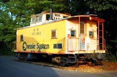 """Chessie System caboose. Not only did the caboose (usually) signify the end of a train, they were the train crew's """"office""""."""