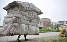 Liu Lingchao built a makeshift dwelling to house himself as he walked back to his hometown in China. He has been walking with this for five years.