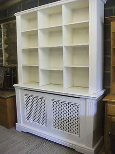 Painted Radiator Cover With Bookcase Above