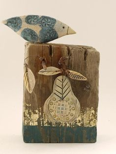 Shirley Vauvelle: Big bird with pear. Earthernware, driftwood, goldleaf.