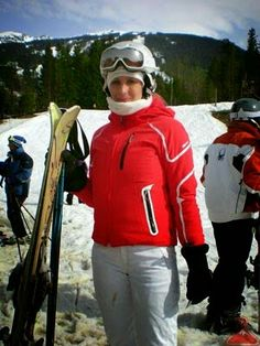 Cydney a Vancouver,  B. C. - native is wearing red with white & black trim on her ski jacket.
