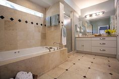 Traditional Full Bathroom with Signature Hardware VINTAGE ROMAN TUB FAUCET AND HAND SHOWER, European Cabinets, Limestone