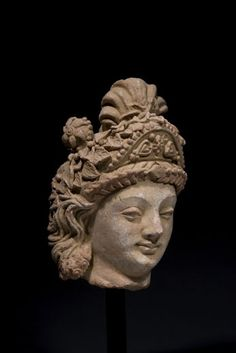 Large terracotta head of a Bodhisattva. Gandhara, Hadda style. 4th-5th Century AD. Height: 13.75 inches (35 cm).