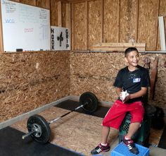 Bryant Phelps rubs chalk onto his hands between lifts in garage of his Providence, Utah, home. The 13-year-old recently competed in a national weightlifting competition an took home several second-place awards. (Photo by John Zsiray)