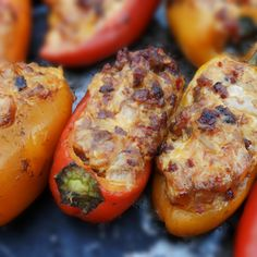 Spicy Brat stuffed peppers; use 1 bag(s) mini sweet peppers; 8 oz cream cheese; 6 oz cheddar, grated; 1/2 tsp red pepper flakes; 2 hot & spicy brat links, casing removed; heat 350 x 20-30 minutes (can be made without brat)
