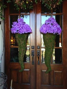 Entry way using moss cones with purple hydrangeas. Also top of entry way is adorned using grapevines with clear lights and mixed ivy     May 2015