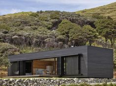 "Residential Architecture: Storm Cottage by Fearon Hay Architects: "".Located on the east coast of Great Barrier Island, New Zealand – a black rough sawn timber box sits looking north to the s… Residential Architecture, Interior Architecture, Interior Design, Design Interiors, Classical Architecture, Sawn Timber, Casas Containers, Black House, Cottages"