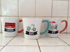 Adorable Target mugs with turquoise, red, and pink accents featuring cities we all love: London with a double decker red bus, Rome with a Vespa, and New York with a hot dog cart.  In target stores now (Jan 2013).
