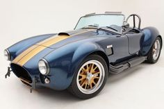 Backdraft Racing - Abu Dhabi Blue with Gold Stripes