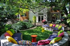 Outdoor Bench with Rainbow Cushions. Design by Harold Leidner.