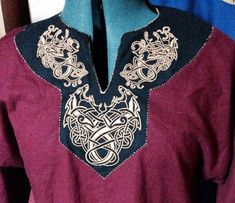 Neckline of the make Viking tunic. Machine embroidered with a dash of artistic license, but still cool.