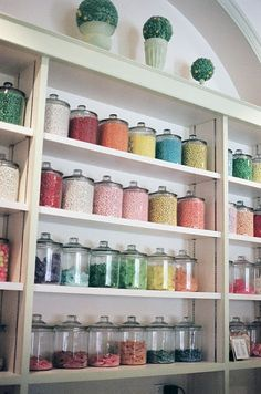 I will have at least one large wall section of clear glass containers... maybe unadorned, maybe with fancy bases... containing all manner of yummy candies, and they will be sorted by color