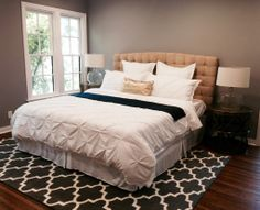 The master bedroom incorporates the navy/gray/flax/white/gold palette found downstairs. Trellis rug is another great find - only $200 at Target.