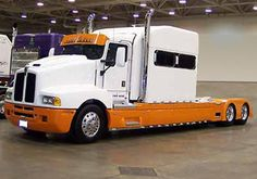 Front Left Orange and White 1998 Kenworth T600 Truck Picture