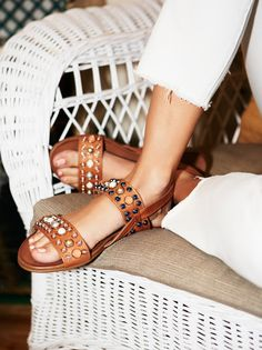 3a96feaa15106 Slip-on leather sandals embellished with allover stone detailing. Adjustable  ankle strap in back and a treaded rubber sole.