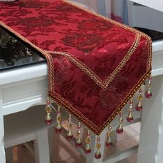Red velvet table runner with gold acents
