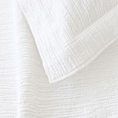 Pine Cone Hill   Hardwood White Matelassé Coverlet   A modern take on the matelassé coverlet with a tone-on-tone, branchlike stripe. 100% stonewashed cotton.