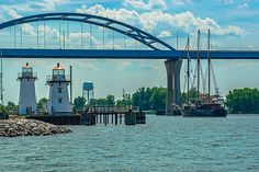 The Leo Frigo Memorial Bridge is a bridge on the north side of Green Bay, Wisconsin. It carries Interstate 43 over the Fox River just south of its mouth into Green Bay (Lake Michigan). Formerly known as the Tower Drive Bridge, it was renamed in 2002 in recognition and appreciation of Leo Frigo, a civic and philanthropic leader in the Green Bay area. Because of the bridge's height and slope, it is prone to being shut down during high wind warnings, heavy fog, blizzards, and icy conditions.
