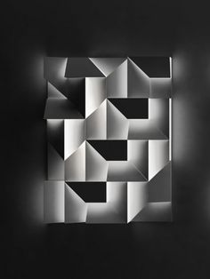 Charles Kalpakian:  graphic composition becomes a texture lit up by the LED bulbs places inside the various elements, creating a canvas of shadows.