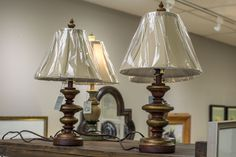 Small antique finished lamps.  Green and yellow, bronze and red.  Robin's Nest Interiors - Louisville Interior Design & Home Accessories Boutique located in the heart of Middletown, KY.