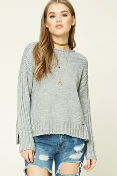 A midweight knit sweater featuring a boxy silhouette, round neckline, dropped long sleeves, ribbed trim along the shoulders and sleeves, and a vented high-low hem.