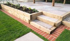 New stepping stones leading to steps and a raised patio with a wooden gazebo, next to a gravel stone planting area. The new turf has a brick mowing st Stock Photo: 350797967 - Alamy Patio Steps, Brick Steps, Garden Steps, Retaining Wall Steps, Lawn And Landscape, Landscape Edging, Backyard Patio Designs, Backyard Landscaping, Mowing Strip