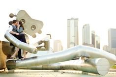 This is a fun photograph!  I definitely want to get a picture of us playing amongst the large outdoor art in Deep Ellum!