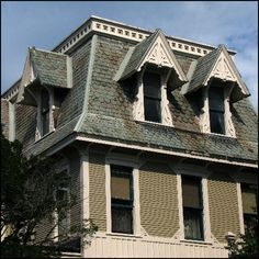 The mansard or mansard roof (also known a curb roof or French roof) is a four sided gambrel-design hip roof defined by two slopes on every one of its own sides with the lower pitch, punctured by dormer windows, at a steeper angle compared to the upper. Low Pitch, Mansard Roof, Gambrel Roof, Building Concept, Dormer Windows, Hip Roof, Roofing Contractors, Roof Repair, Cabin