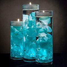 Teal Floral Centerpieces with LED Lights and Floating Candles Sweet 16 Centerpieces, Floating Candle Centerpieces, Wedding Table Centerpieces, Floral Centerpieces, Centerpieces With Lights, Tiffany Blue Centerpieces, Water Beads Centerpiece, Teal Wedding Decorations, Turquoise Centerpieces