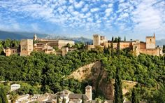 Granada Spain's dominant sight is the Alhambra, the last and greatest Moorish palace. Right up to its fall in early Alhambra was thoug. Spain Holidays, Famous Castles, Moorish, Vacation Trips, Vacations, Places To Visit, Around The Worlds, City, Andalusia