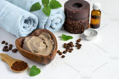 Spa setting with cosmetic clay mask for body, Towel Essential o Photos Spa setting with cosmetic clay mask for body, Towel Essential oil and coffee beans by colnihko