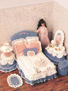 "A feminine bed complete with eyelet lace, ribbons and more sets the tone for the rest of the lovely room. Each of the 10 designs is made using sport-weight yarn. Perfect for an afternoon of fun with your 11 1/2"" fashion doll."