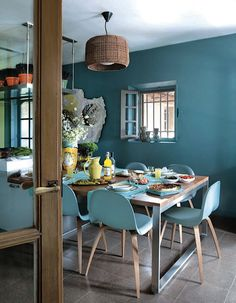 Love this color. Blue is big this year but most people don't think to use it in a kitchen/dining space.