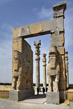Iran Persepolis _  The two lamassu on the western portal of the Gate of All Nations - the entrance to Persepolis. This lamassu is a bull with the head of a bearded man.  The Lamassu is an apotrope, a mythological creature that wards off evil, originated in Babylonia and Assyria. and adopted by the Achaemenids.