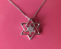 """For your consideration is this #Diamond #Star of #David #Pendant #Necklace. Pendant features round cut diamonds in a Star of David design. Pendant is suspended from a 16"""" chain and both pieces are 14K White solid stamped Gold. Pendant measures approx. 5/8"""" x 5/8"""" and comes in pendant box. Total Carat Weight 0.03 ct. $350"""