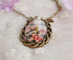 Vintage style glass floral bird pendant necklace