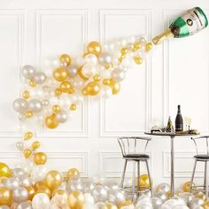 Champagne Bottle Balloon on the Wall - Easy New Years Eve Decor
